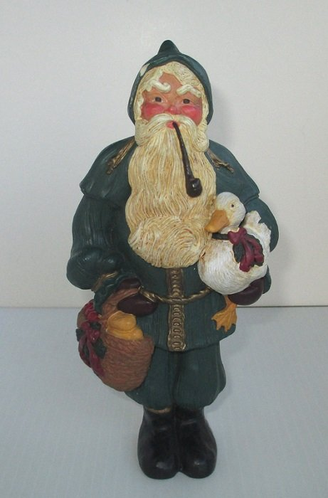 From the Lenox Country Santas collection this Santa Claus stands 8 inches tall. He's carrying a duck. Dated 1996. Stands on table or hangs on wall.