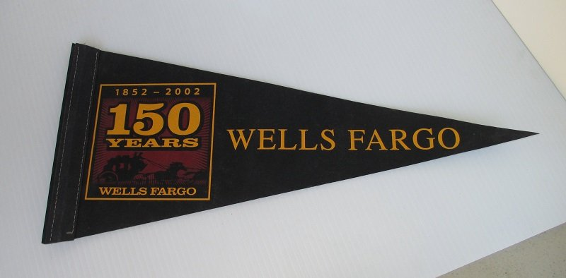 18 inch long felt pennant commemorating the 150 year anniversary of Wells Fargo Bank. Comes in a Wells Fargo box, but the box was for candy.