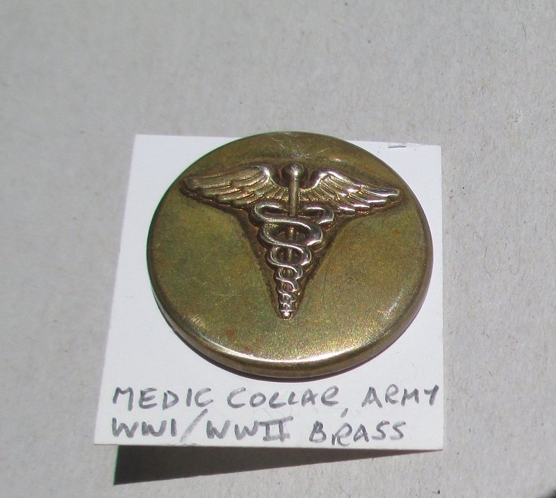 This U.S. Army Medic Collar Pin. Made of brass and stated to be from WWI to WWII time frame. Measures 1 inch across the center.