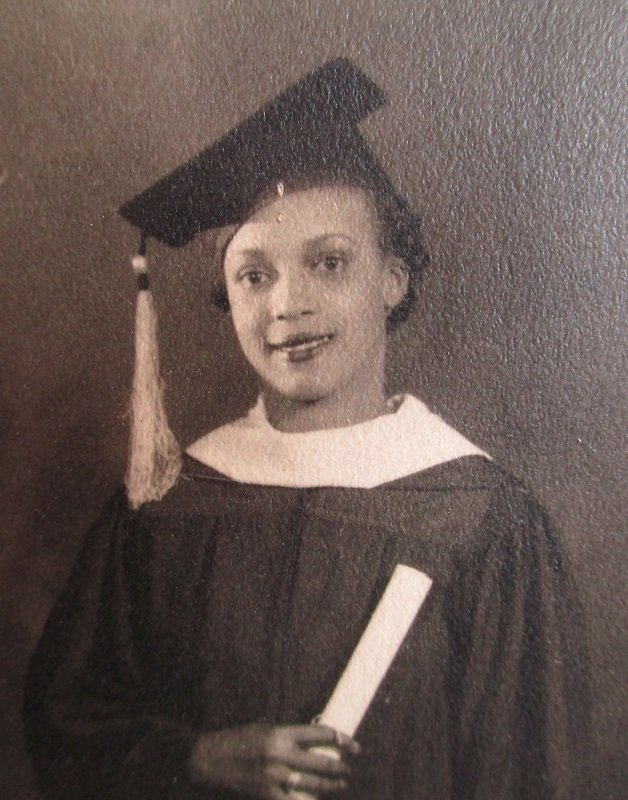 Photo of a Black African American woman graduate in cap and gown with diploma. Circa 1930s New Orleans Louisiana.