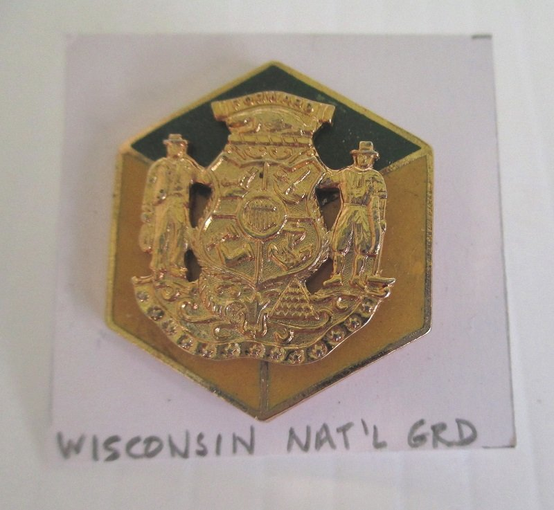 This Wisconsin National Guard insignia pin has the motto