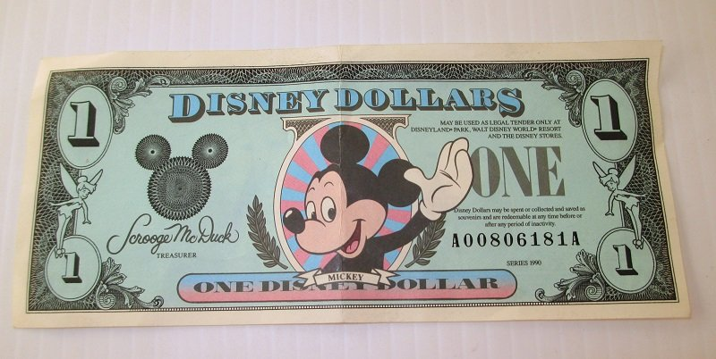 Front of Series 1990 Disney Dollar with unique serial number of A00806181A. Walt Disney Company, Disneyland Anaheim California.
