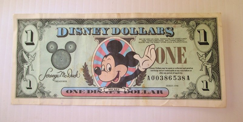 Front of 1998 Disney Dollar with unique serial number of A00386538A. Created by Walt Disney Company for Disneyland in Anaheim.
