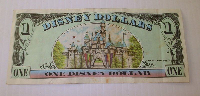 Back of 1998 Disney Dollar with unique serial number of A00386538A. Created by Walt Disney Company for Disneyland in Anaheim.
