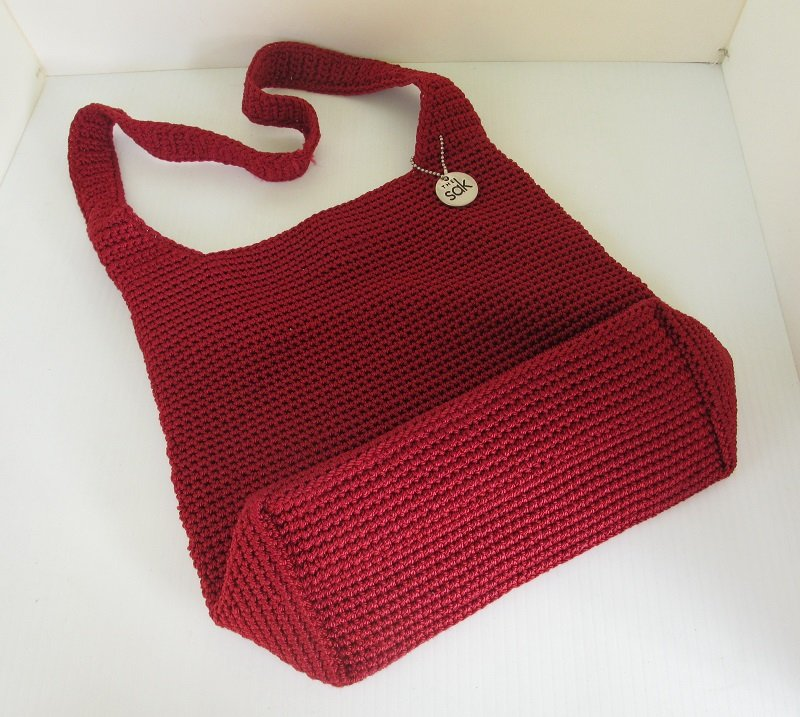 Crocheted shoulder bag purse from The SAK. Burnt red in color ...