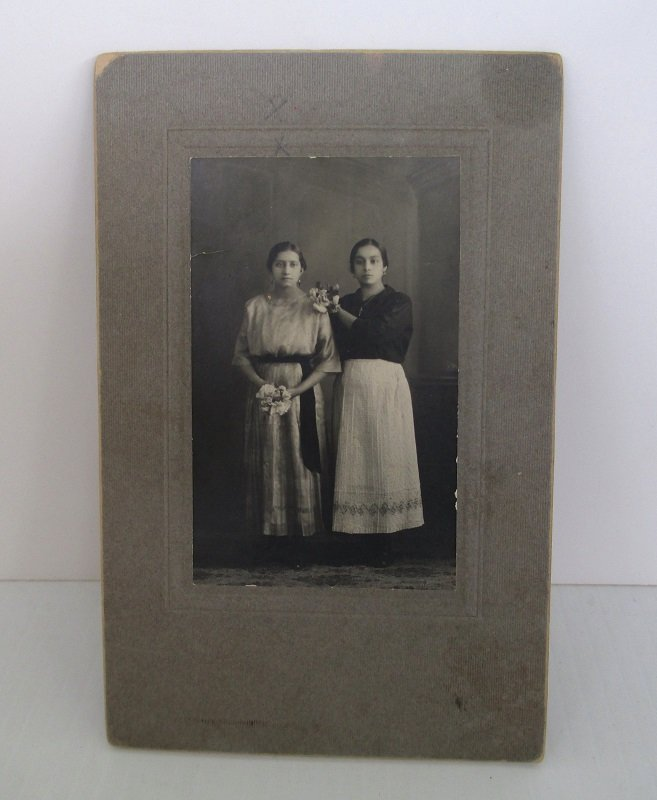 Circa 1910 antique photo of 2 hispanic women, each holding a bouquet of flowers. Unknown location. Possible name of Zendejas.