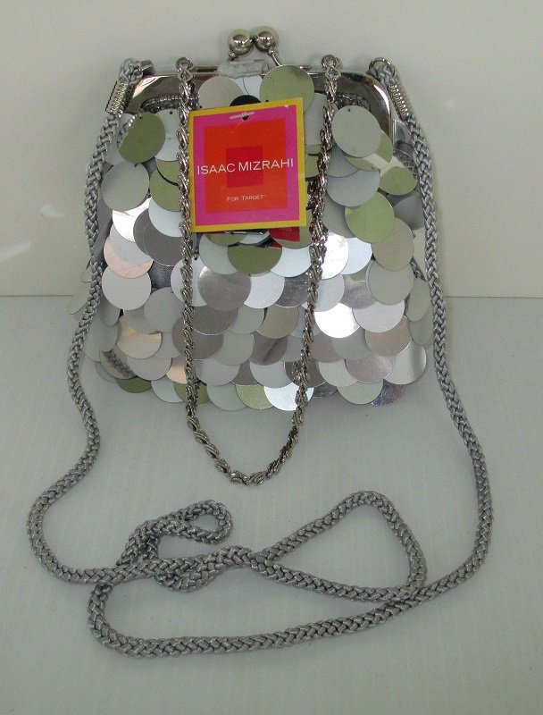 Silver sequined evening bag by Isaac Mizrahi. Use as a shoulder bag, or purse. 5.5 by 5 inches. Never used, still has store tags attached.