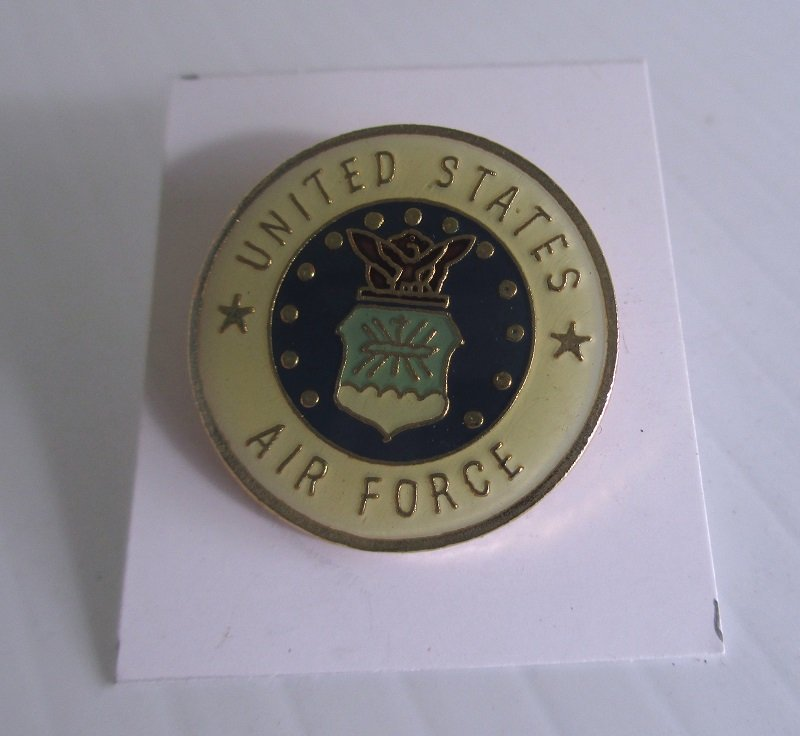 This USAF United States Air Force insignia pin is brass with an enamel face. The back is marked PWII. Worn on uniforms. Unknown date.