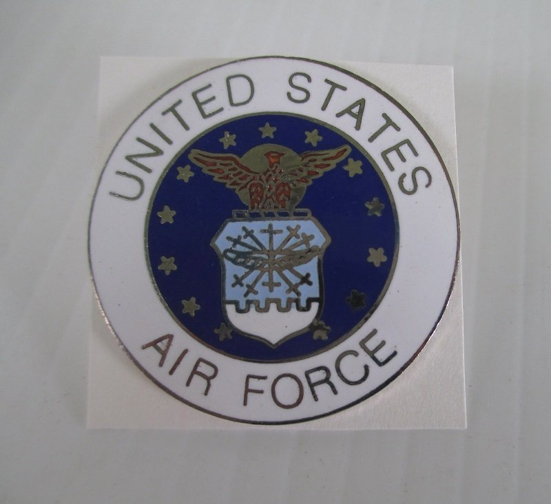 This USAF United States Air Force insignia pin is brass with an enamel face. Measures 1.5 inches across. Worn on uniforms. Unknown date.