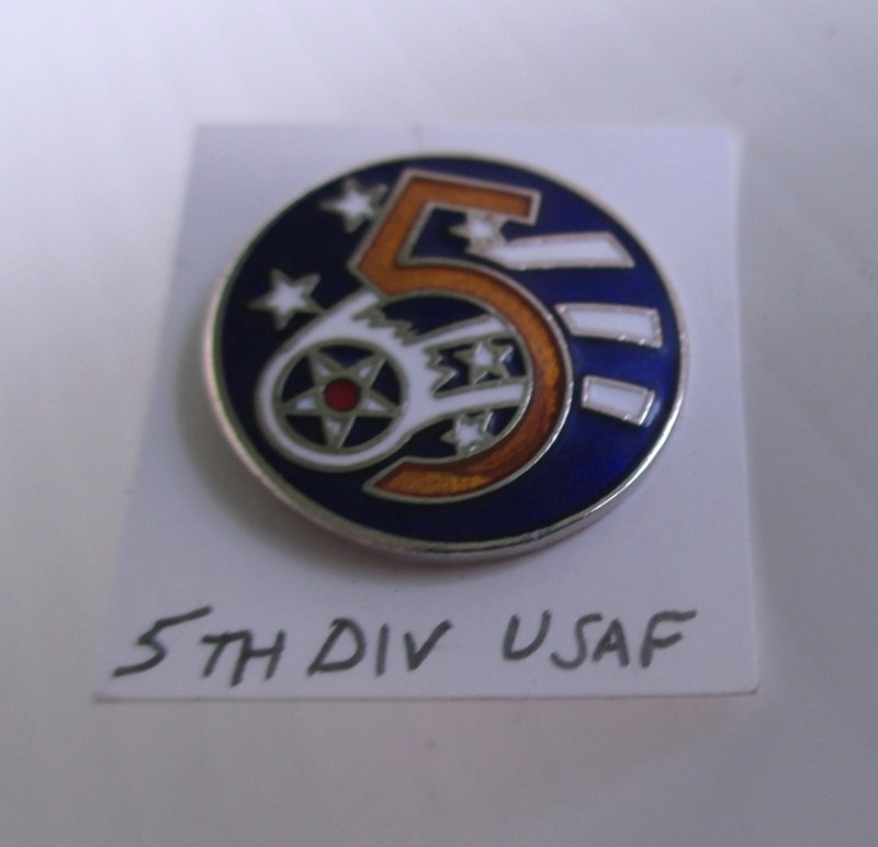 This USAF United States Air Force 5th Division insignia pin is brass with an enamel face. Worn on uniforms. Unknown date, unknown maker.