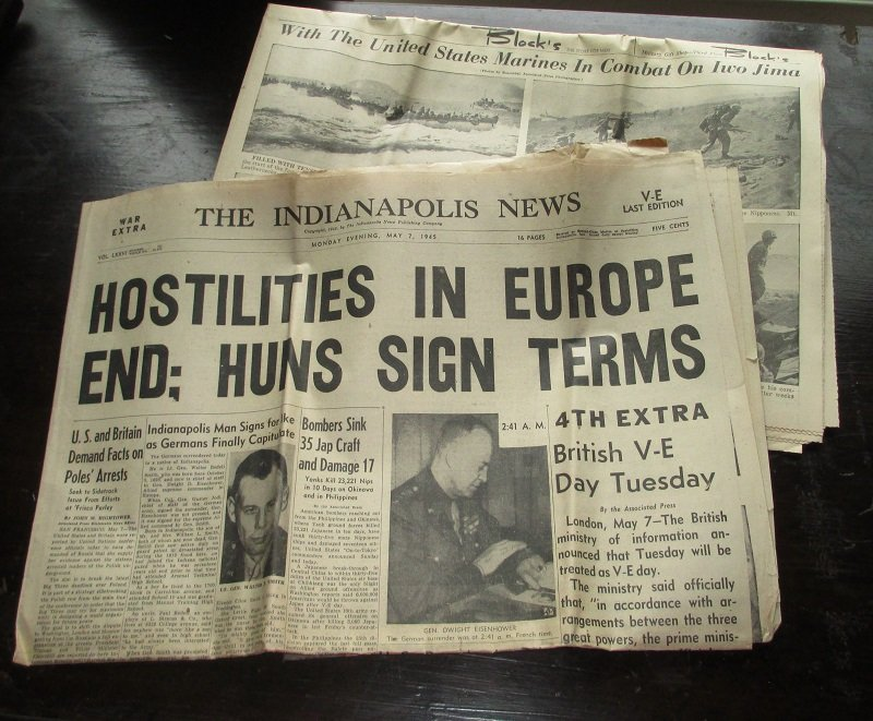 Indianapolis News newspaper dated May 7th, 1945, V-E Day. It announces the end of WWII Europe hostilities. Bonus newspaper section included.