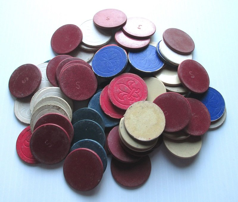 1940s Clay and Cardboard Poker Chips. Total of 69 pieces in colors of red, blue, and cream.