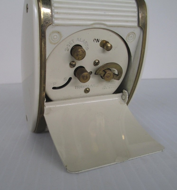 Vintage Art Deco Travel alarm clock from Westclox of La Salle Illinois. 1940s to 1950s era. Has roll top. Great working condition.
