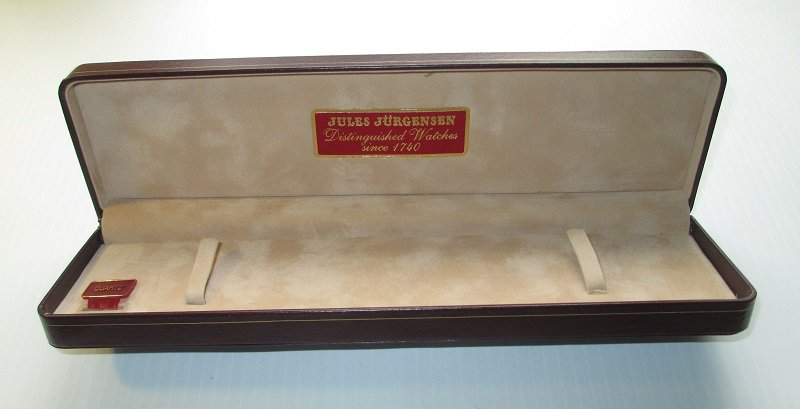 Original presentation box for a Jules Jurgensen watch. Both inner and outer boxes. Inner box is leather with suede lining. Excellent condition.