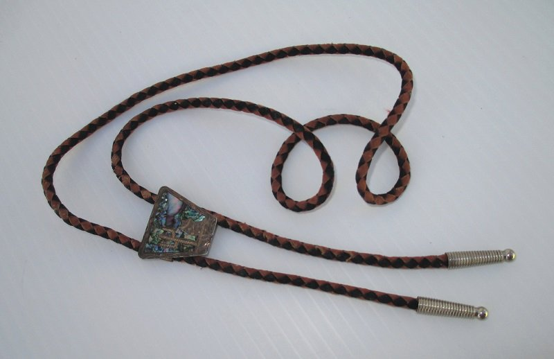 Vintage 1940s Sterling Silver and Abalone Bolo Tie. Signed with maker's initials and stamped Mexico. Features man taking siesta by saguaro cactus.