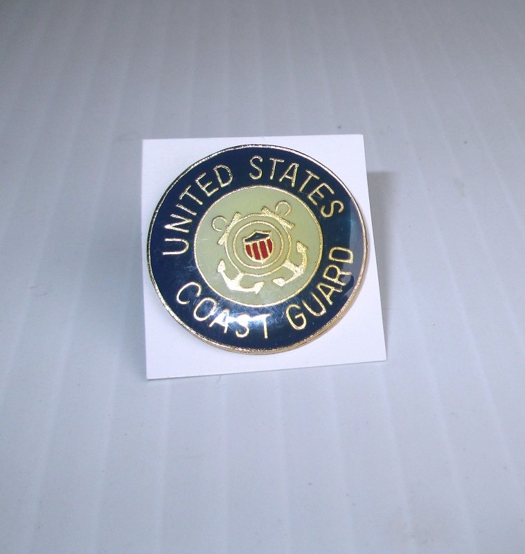 U.S. Coast Guard Official Seal Enamel and Brass Insignia pin. Blue and cream in color. Measures 1 inch across the face. Marked PWII. Unknown date.