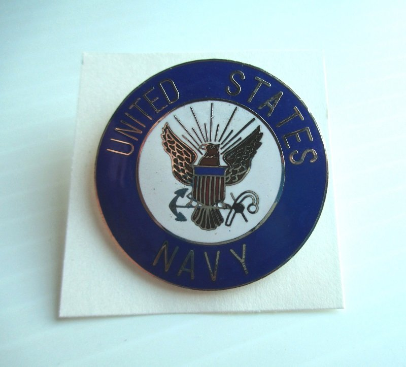 U.S. Navy USN Enamel and Brass Insignia pin. Blue and white in color. Measures 1.5 inches across the face. Unknown date.