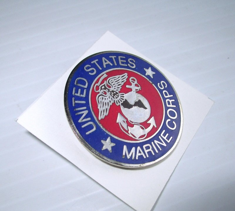 U.S. Marine Corps Enamel and Brass Insignia pin. Blue and red in color. Measures 1.5 inches across the face. Unknown date.