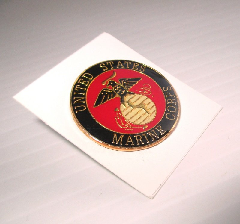 U.S. Marine Corps Enamel and Brass Insignia pin. Blue and red in color. Measures just under 1 inch across the face. Marked PWII. Unknown date.