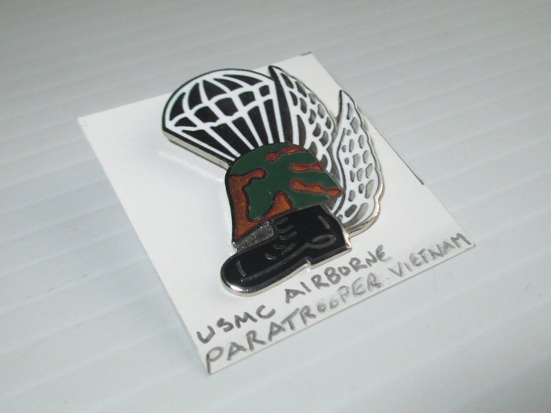 U.S. Marine Corps Airborne Paratrooper Enamel and Brass Insignia pin. Stated to be Vietnam era. Features a parachute, wings, a helmet, and a boot.