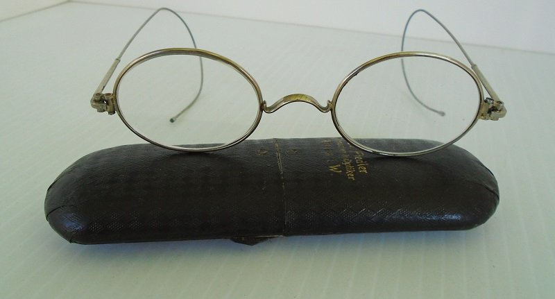 German made eyeglasses in pull a part case. Case marked Ed Fiedler, Uhrmacher & Optiker, Altena L.W.