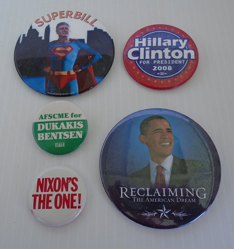 Group of 5 Presidential campaign pinback buttons. Bill Clinton, Hillary Clinton, Barack Obama, Richard Nixon, Michael Dukakis and Lloyd Bentsen.