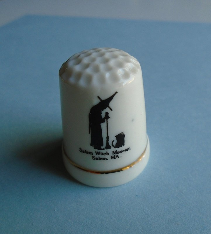 Porcelain china thimble from Hampton Beach New Hampshire. White with gold trim. 1.25 inches tall. Unknown age, purchased at an estate sale.