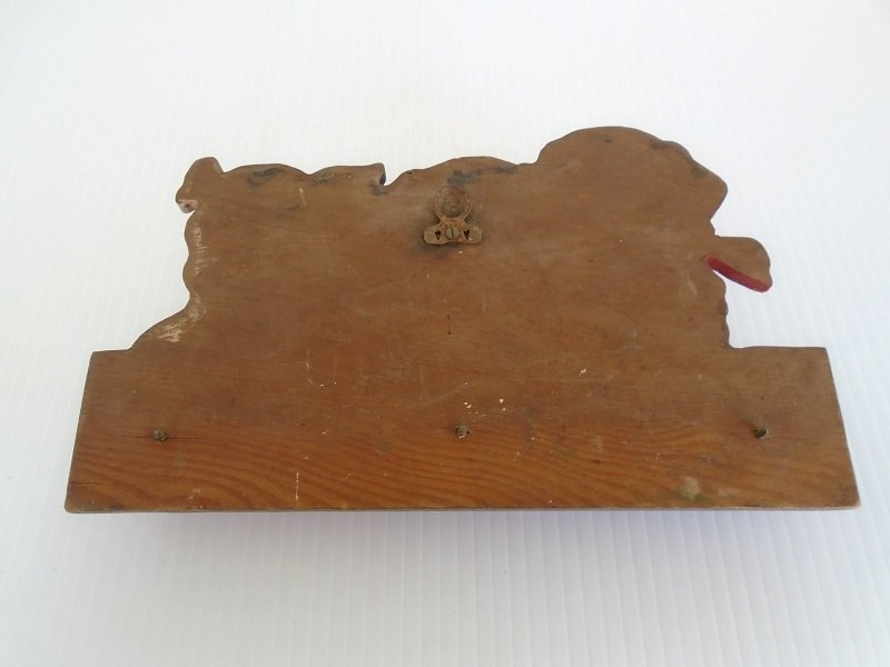 Rear side of antique puppy wall plaque key holder. circa 1930s.
