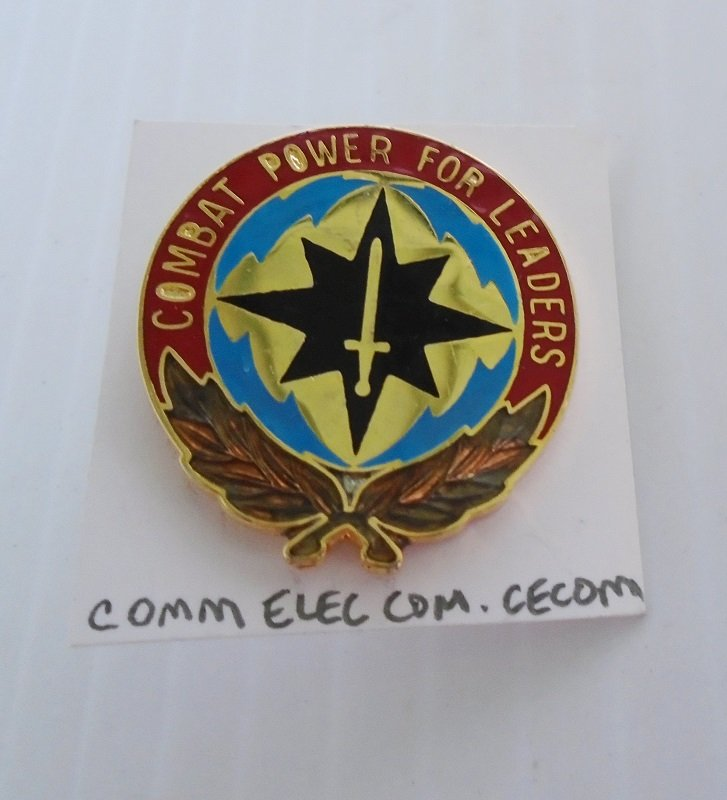 U.S. Army metal insignia pin for the Communications Electronics Command CECOM. Marked V-21 Made in U.S.A. Has Combat Power For Leaders motto.