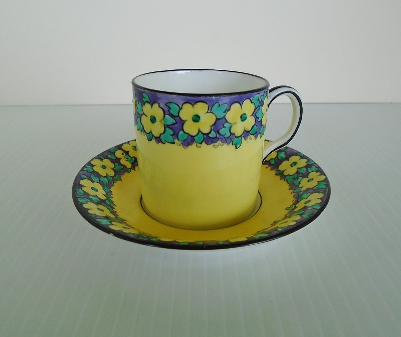 Vintage Chelson China Demitasse set. Cup and saucer in bright yellow with purple flowers. Estimated to be 1940s to 1950s. Offered by kenoticket