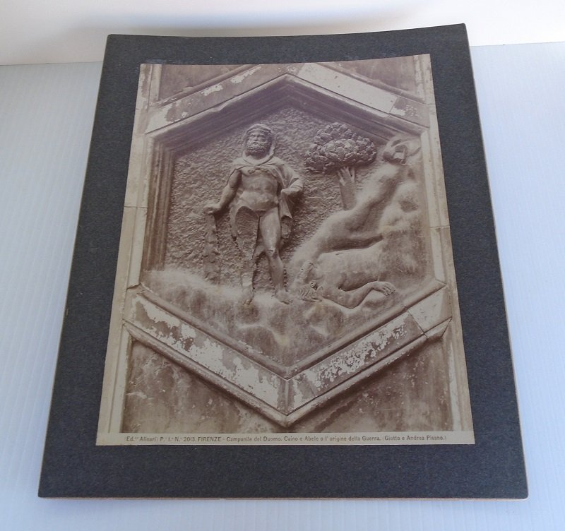 Circa 1896 print/picture. Cain and Abel. Antique photo of one of the biblical panels on the Florence Italy Cathedral. Alinari, Andrea Pisano.