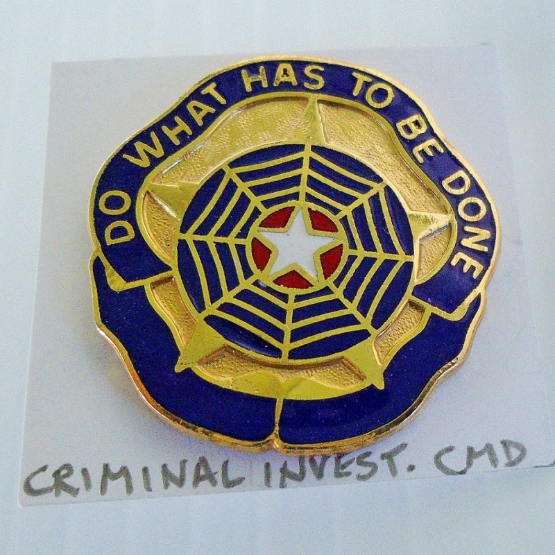 U.S. Army metal insignia pin for the Criminal Investigation Command Unit. Marked E23. Has the motto