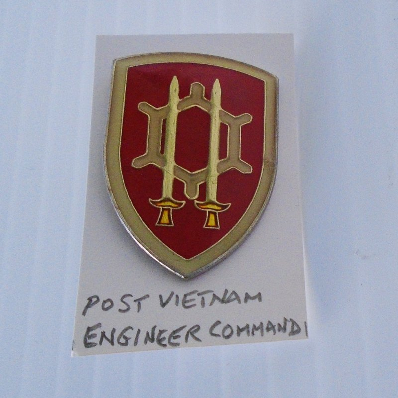 Enameled metal insignia pin for the Engineer Command, U.S. Army. Stated to be post Vietnam. Worn on military uniforms. Estate sale purchase.