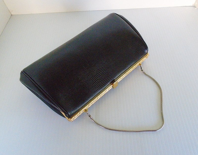 26e39b4b2d6 Leather Etienne Aigner vintage 1970s black clutch purse. Snake embossed with  gold color hardware.