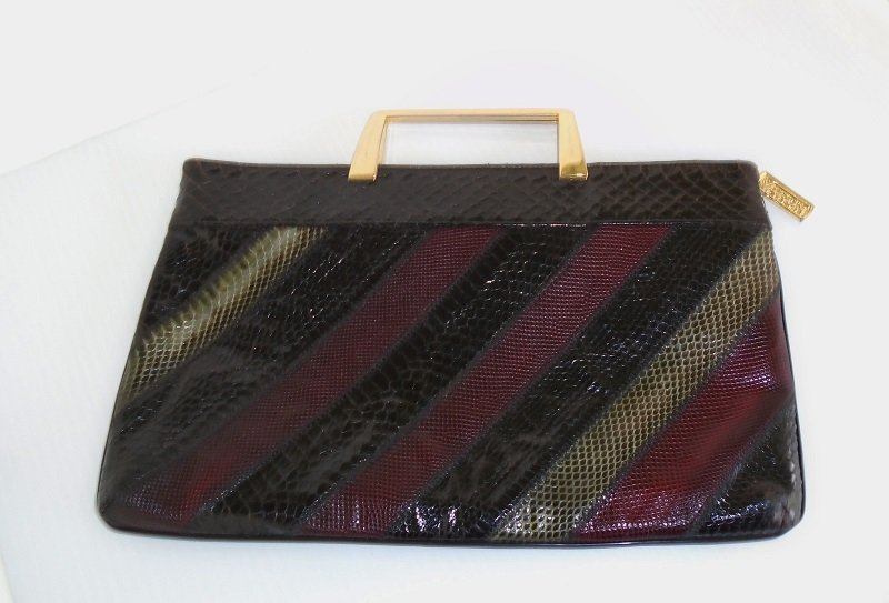 Varon vintage 1960s patchwork snakeskin handbag. Maroon, silver, and black in color with gold color hardware. Estate item offered by kenoticket.