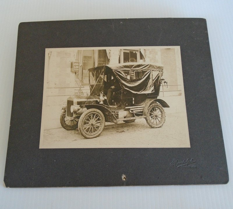 1908 Ford Model T antique real photo. About 10 by 12 inches. Man sitting in driver's seat. Photo by Randolph Studio, Chanute Kansas.