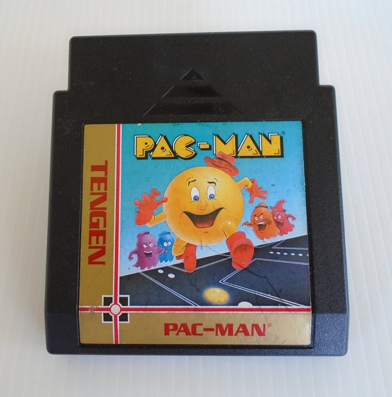 NES Nintendo Pac-Man game cartridge made by Tengen. One of the most popular games ever. Chase and be chased by ghosts.