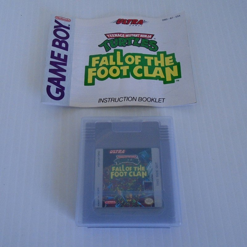 For the Nintendo Game Boy system, Teenage Mutant Ninja Turtles, Fall of the Foot Clan. Cartridge, booklet, and protective case. Dated 1990.