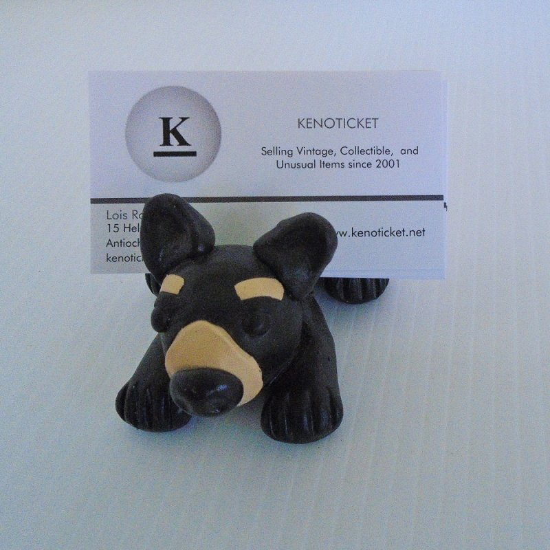 Business card holder in the shape of a bear. Obtained from a retiree of Bank of the West. The bear is the bank's logo. Dates to late 1990s.