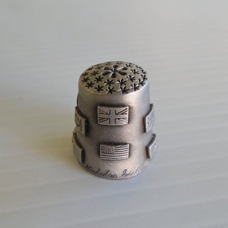 World's Fair 1982 Knoxville Tennessee pewter thimble. Has flags of some participating nations. One inch, signed Nicholas Gish.