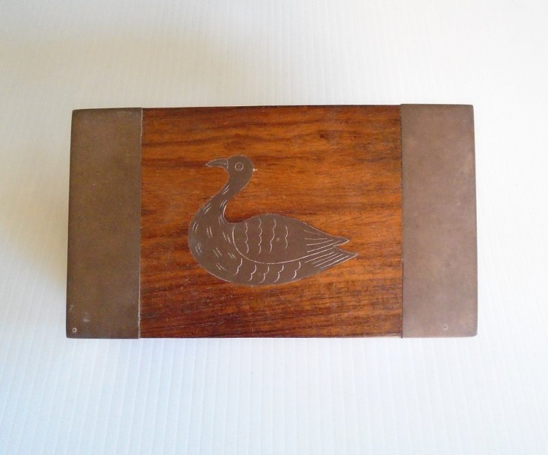 Rosewood box highlighted with brass accents. Centerpiece is a brass duck or pheasant. India, 4 by 7 by 1.5 inches. From a Beverly Hills estate.