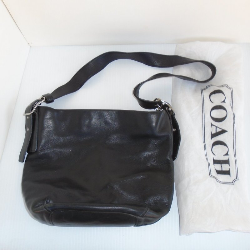 Beverly Hills estate find. Black, extremely soft leather Coach Legacy Bucket bag. Macy's tag inside. Serial number inside. Authenticated online.