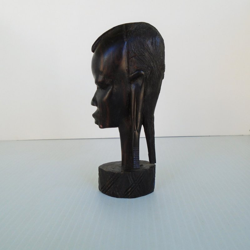 Circa 1960s hand carved African Tribal Warrior head sculpture. Made of a deep dark wood and has sticker stating