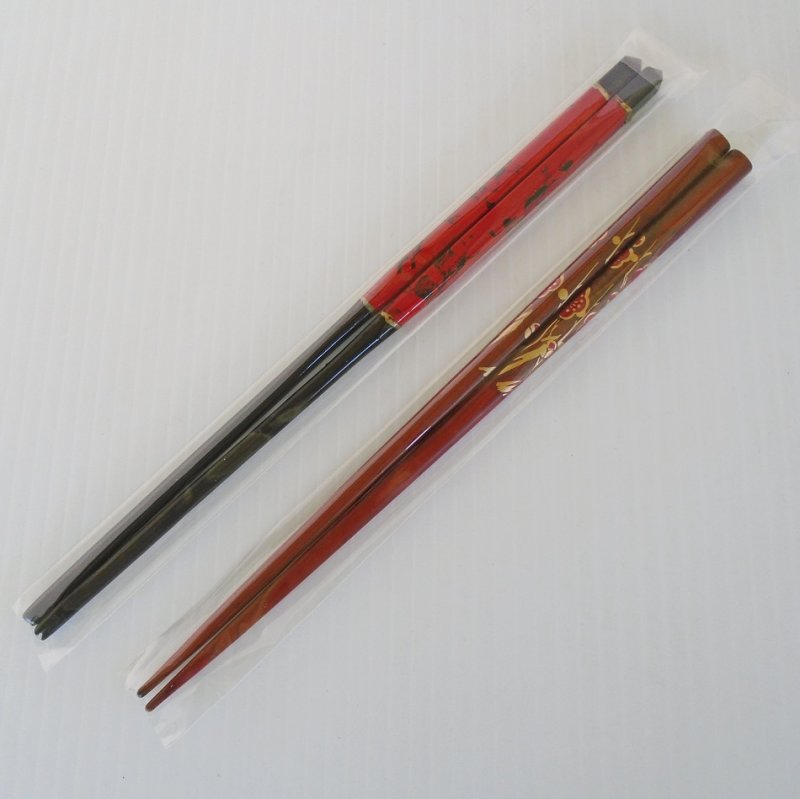 2 pair of chopsticks, one pair is black and red, the other is brown with red flowers. More towards the high end in design. Each in sealed packaging.