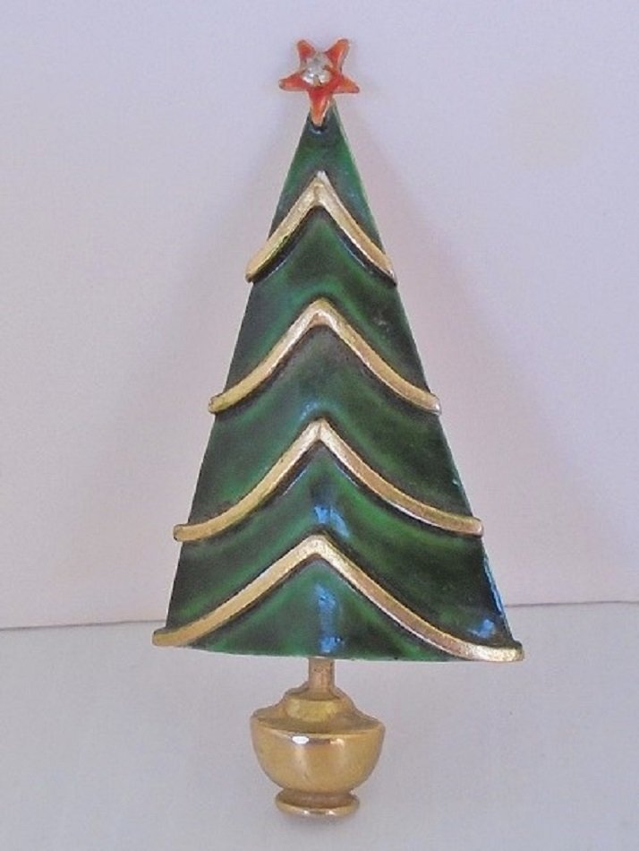 Pin brooch depicting a Christmas Tree and signed on the back 'Original by Robert'. Brooch is 3 inches tall and dates between 1955 to 1979. Estate find