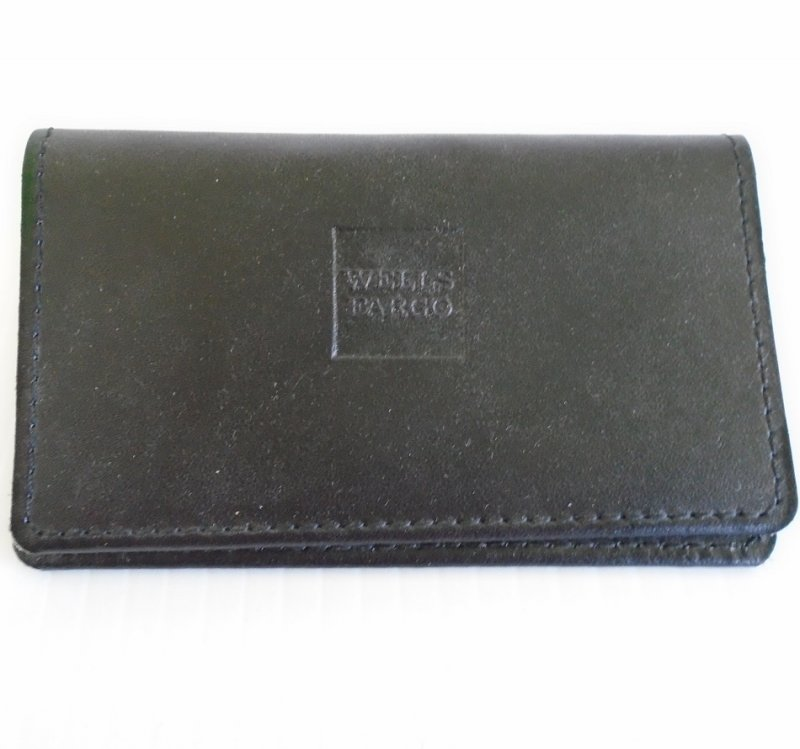Vintage 1970s Wells Fargo business card holder. Two pockets inside. Possibly leather. The words Wells Fargo embossed on top.