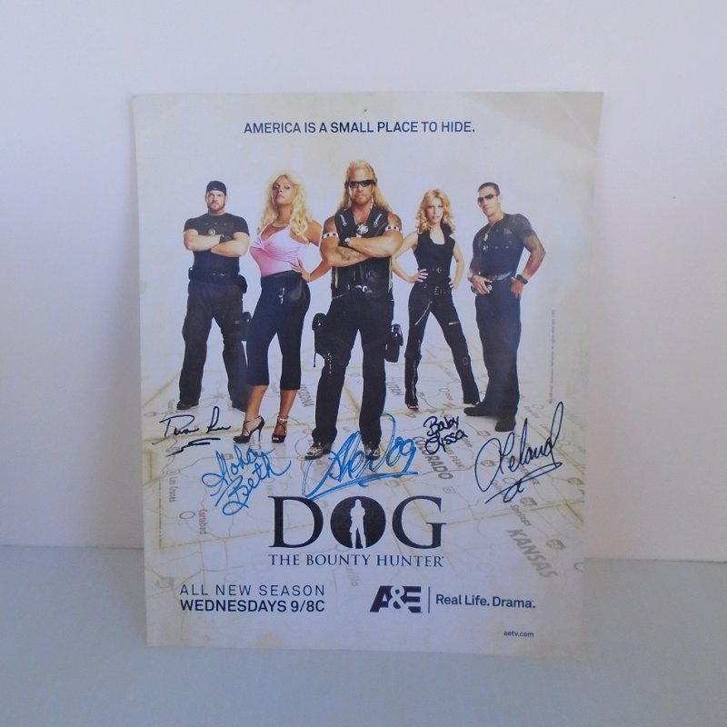 Official A&E 8x10 inch mini poster announcing the new season of Dog The Bounty Hunter. Signed by 5 cast members including Dog and his wife. Dated 2008