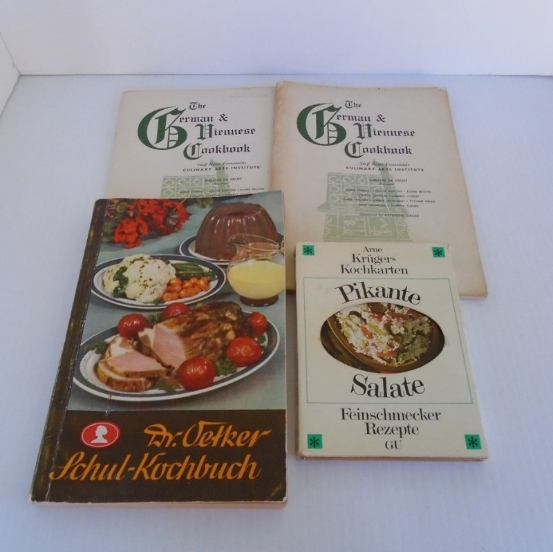 Four vintage German cookbooks dating between 1939 and 1956. Actually, one is a set of recipe cards. Estate sale finds.