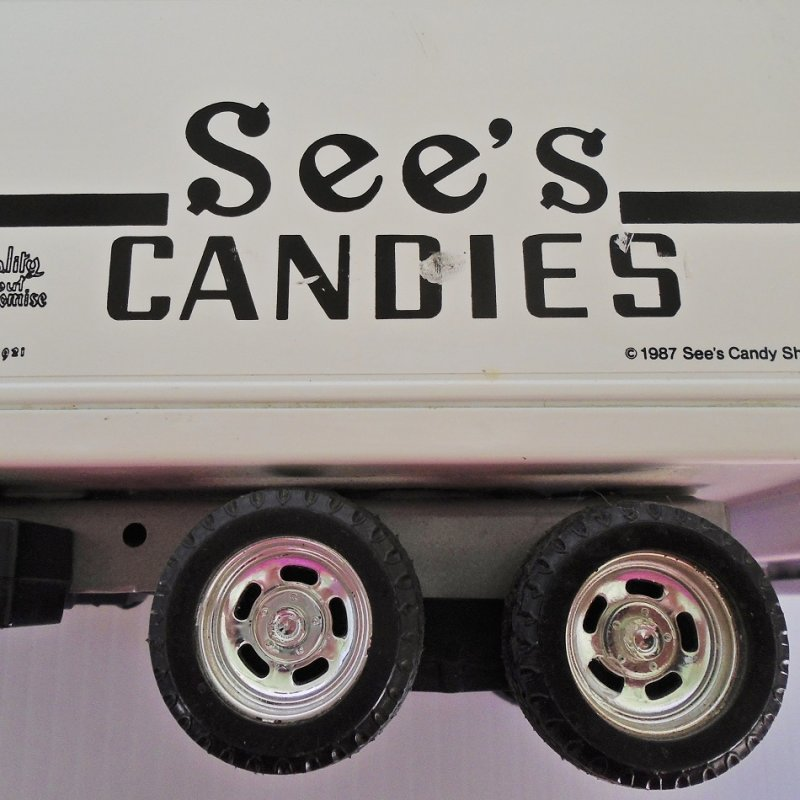 ERTL 3605 showing defect in decal on one side. See's Candies delivery truck. Probably 1980s. Approx 10 by 3 by 4 inches.