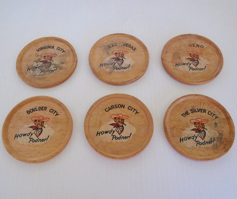 Set of 6 1950s wood coasters featuring Vegas Vic, a famous logo of several casinos. Nevada towns represented - Las Vegas, Reno, Virginia City, others